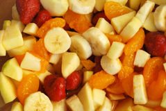 Fruits mix. Mix of fruits - bananas, apples, mandarins and strawberries stock photo