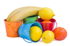 Fruits mix. In colorated tin buckets Royalty Free Stock Photo