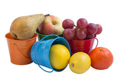 Fruits mix. In colorated tin buckets Stock Photography
