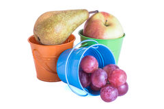 Fruits mix. In colorated tin buckets Royalty Free Stock Photography
