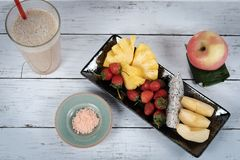 Fruits mixed snacks and fruit juice. Picture of mixing  fruit snacks and fruit juice on the table Stock Photography