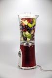 Fruits in a mixer royalty free stock photos