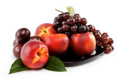 Fruits nectarine and a bunch of grapes . Royalty Free Stock Photo