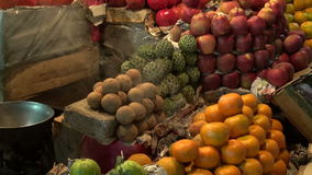 Fruits in night asia market and incence smoke stock video