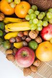 Fruits and nuts. Fresh seasonal fruits and nuts arrangement in vertical composition stock photo