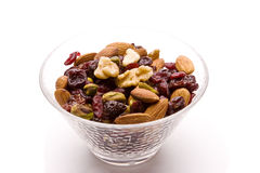 Fruits and Nuts. Bowl of dried fruits and nuts isolated on white with a drop shadow Royalty Free Stock Photo