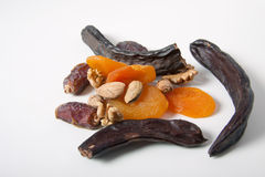 Fruits Nuts carob dat dried apricots almond spice Stock Photo