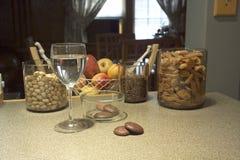 Fruits nuts and coffee. Fruits, nuts and coffee on kitchen counter Royalty Free Stock Photos
