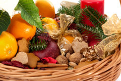 Fruits, nuts and gingerbreads in basket Royalty Free Stock Photography
