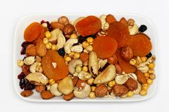 Fruits and nuts plate. Dried fruits and nuts at rectanular plate Stock Photos