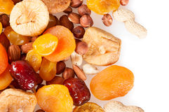 Fruits and nuts on a white background Royalty Free Stock Photography