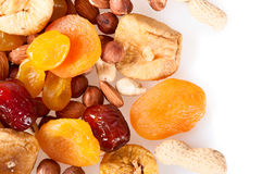 Fruits and nuts on a white background. Royalty Free Stock Photos