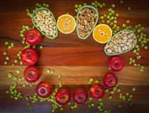 Fruits and nuts on wooden table Stock Photos