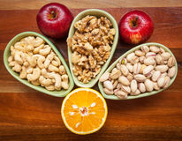 Fruits and nuts on wooden table top view Stock Photo