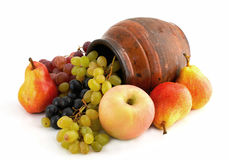 Fruits and old clay pottery. Different fruits and old clay pottery Royalty Free Stock Photography