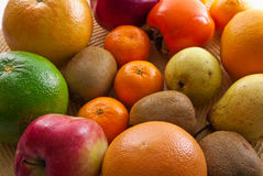 Fruits orange apple kiwi kaki pear grapefruit Stock Photos