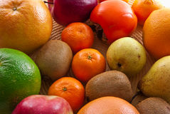 Fruits orange apple kiwi kaki pear grapefruit Royalty Free Stock Photos