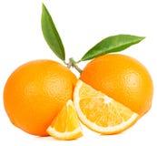 Fruits oranges avec les lames vertes Photos stock