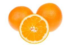 Fruits oranges entiers et coupés en tranches frais, d'isolement sur le blanc Photos libres de droits