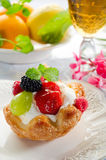 Fruits pastry. With fresh cream and glass of tea Stock Photography