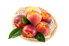 Fruits of peach and nectarine in a wicker dish. Royalty Free Stock Photo