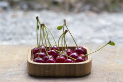 Fruits with peduncles in a wooden bowl Royalty Free Stock Photography