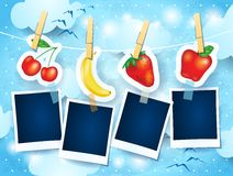 Fruits and photo frames on sky background Royalty Free Stock Image