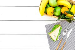 Fruits for picnic. Apple, banana, tangerine on white wooden background top view copyspace Stock Photo