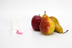 Fruits and pile of pills Stock Image
