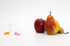 Fruits and pile of pills Stock Photo