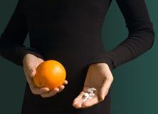 Fruits or pills Stock Photos
