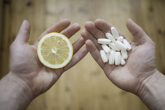 Lemon or pills? Stock Images