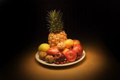 Fruits with pineapple. Evening still life Royalty Free Stock Photos