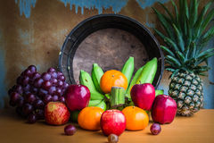 Fruits placed on a wooden table. Apple and several kinds of fresh fruits placed on a wooden table Royalty Free Stock Image