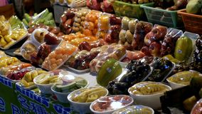 Fruits in plastic containers in a showcase at the Jomtien night food market. Pattaya, Thailand.  stock video footage