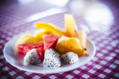 Fruits on plate. Some sliced mixed fruits on a plate Stock Image