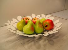 Fruits on the plate as decoration of the kitchen table stock photos