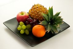 Fruits on plate Stock Photos