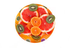 Fruits plate with grapefruit, kiwi and orange slices Stock Image
