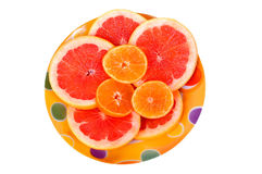 Fruits plate with grapefruit and orange slices Royalty Free Stock Photo