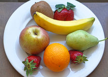 Fruits plate. Mix of fresh fruits served at platter Royalty Free Stock Images