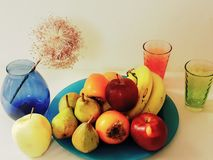 Fruits on plate still life ,aplle bananas pears photo art. Fruits on blue plate still life , organic apple bananas pears photo art stock photos
