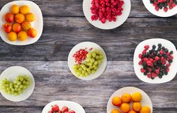 Fruits on a plate. vegetarian food on wooden background. vegan food top view.  stock photos