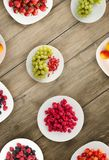 Fruits on a plate. vegetarian food on wooden background. vegan food top view.  stock photography