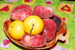 Fruits plums and flat peaches. Very juicy fruits, plums flat peaches Royalty Free Stock Image