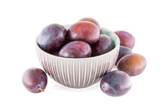 Fruits plums ina bowl isolated Stock Photos
