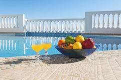 Fruits at poolside. Fruits and vegetables at poolside Stock Images