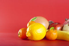 Fruits on red. Fresh fruits on red background Stock Image