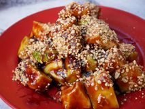 Fruits Rojak in Penang, Malaysia. Traditional Asian Fruits Mixed Salad, with ketchup. peanut and sesame seeds Stock Photo