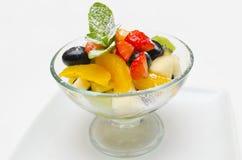 Fruits salad. Fresh fruits salad with fresh mint stock photography